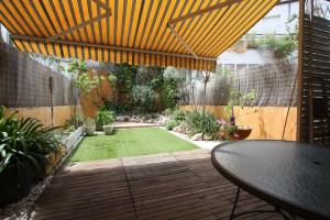 casa amb jardí al centre