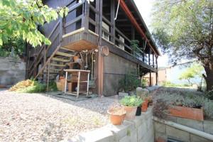Casa de fusta amb jardi